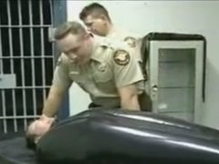 Cops put guy in rubber sleepsack