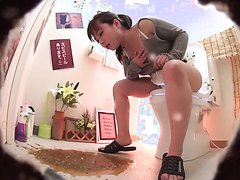 Japanese girl puked all over the toilet room