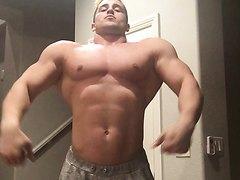 bodybuilder flexes
