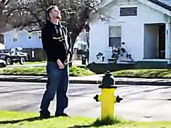 guy pisses on hydrant