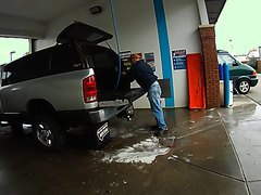 men piss while he wash his car