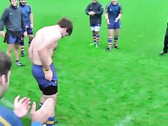 Naked rugby man run front team