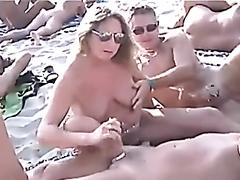 Lots of handjobs on the nudist beach