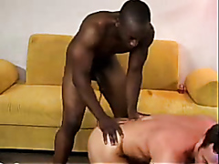 Interracial gay couple in hardcore action