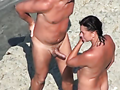 Cougar gets owned by two guys on a beach