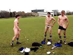 Naked footballers have fun together