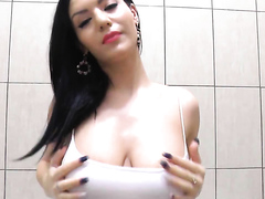 Awesome babe teasing in the bathroom