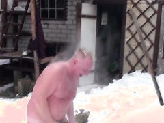 Funny mature men in the cold snow