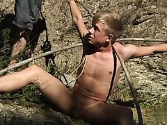 twink tied and abused in the woods