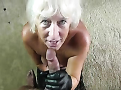 Gray-haired granny sucking a fat cock