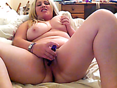 Chubby blonde loves her blue vibrator