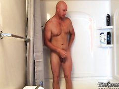 Bald man shitting and shower