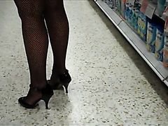 Sexy milf in fishnets walking around in the store