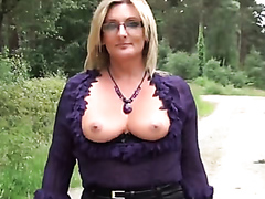 Classy blonde flashes her tits in public