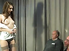 Slim brunette is owned by older studs in a gangbang