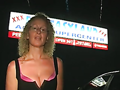 Curly blonde sucks dick through a hole