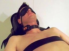 A young man is tightly restrained and played with