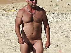 Mature man in the nude beach