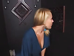 Mature blonde handling a cock glory hole style