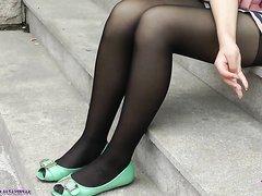 Asian University student show her black pantyhose