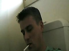 Hunky Guy in green t shirt smokes and pisses in the bog