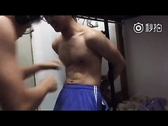 young asian  boy gut punched