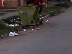 Shitting In A Garbage Container - video 2