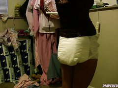Girl really messes diaper, and gets it squished