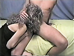 Curly mature gets fisted in both holes