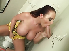 Slut with huge tits sucking a dick in the toilet