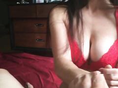 Busty brunette jerking a big dick topless