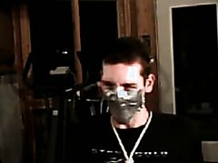 Tape gagged guy breath controlled