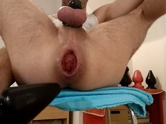 Using huge butt plug to expose rosebud