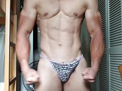 Cute Asian guy flexes in panties