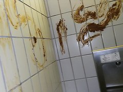 Decorating / smearing pissoir with scat