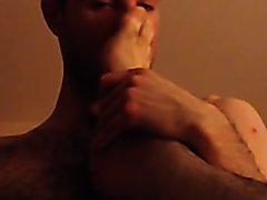 Horny slave sniffing sweaty feet 2