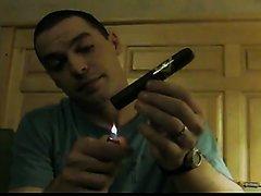 Handsome American lad smoking big cigar