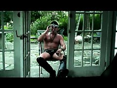 Hot leather daddy in shades smokes cigar and plays