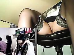 Horny secretary masturbating at work