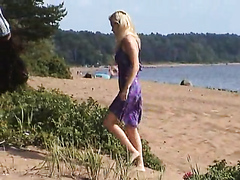 Beautiful blonde rocked hard on the beach