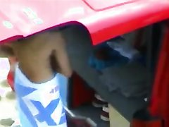 Young guys change clothes behind a van
