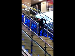 Drunk guy pissing on the stairs at the mall