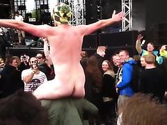 Naked guys enjoying a concert
