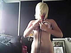 Kinky blonde ties herself up and masturbates