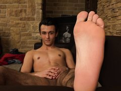 Naked guy shows feet