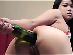 Asian slut likes toying with her ass