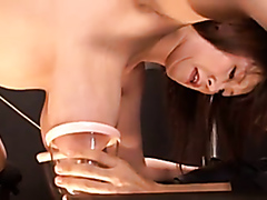 Busty Asian gives her milk up