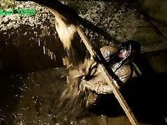 Worker under slurry shower