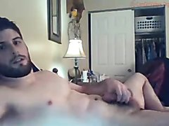 Handsome cam guy shows off.