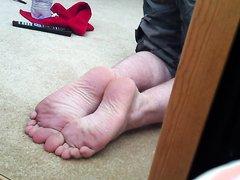 Bi boy rubs lube over his soles